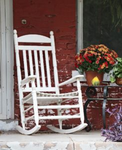 a white wooden rocking chair