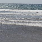why the sea is salty a photo of the ocean waves from the shoreline. the horizon is visible in the far distance
